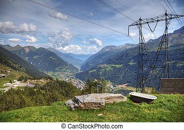 Modern aerial view of swiss alps - powerline, roads and strange bath.