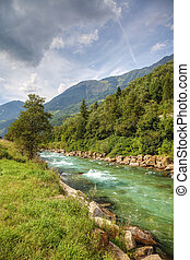Clean mountain river in swiss Alps, Europe.