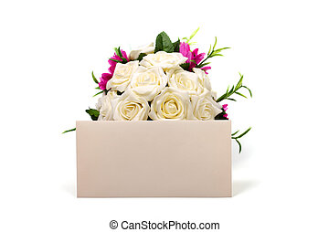 Bunch of roses and textured blank envelope isolated on white background.