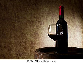 Red wine, bottle, glass and old barrel - the still life with...
