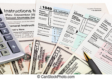 Tax forms 1040. - Tax forms 1040 with pen, calculator and...
