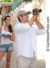 Touristic couple with camera