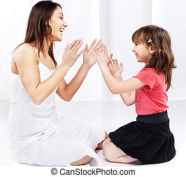 Woman and child laughing and playing - Woman and child...