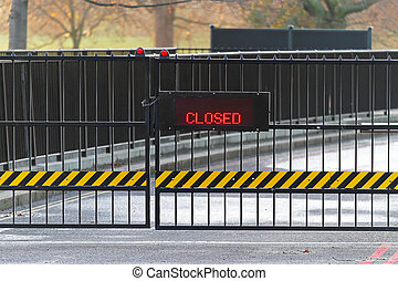 Closed gate with red LED information display