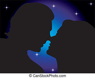 Lovers Silhouettes - man and woman about to kiss on a bluish...