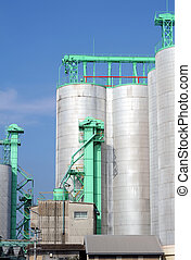 silo - industrial storage silo and blue sky