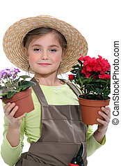 Little girl holding flower pots