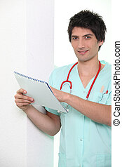 Male nurse holding chart