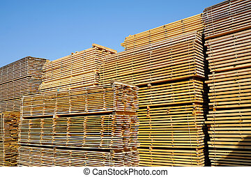 Lumber - Stack of boards in lumber yard