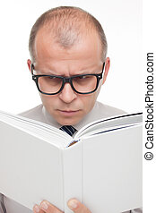 Man with glasses reading a book isolated on white