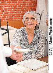 senior woman in a lovely restaurant