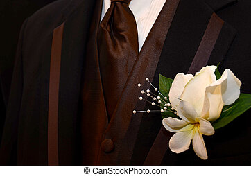 rich brown tuxedo - Boutonniere pinned on brown tuxedo lapel...