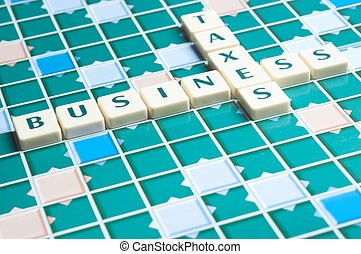 Business and taxes word made by letter pieces