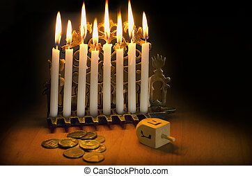 Jewish Holiday Hanukkah - Photo of a dreidel (spinning top),...
