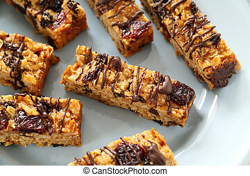 Chocolate Muesli Bars - Fresh baked muesli bars with melted...