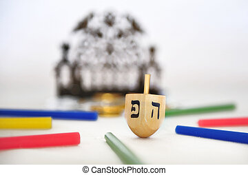 Dreidels, Gelt and Hanukkiya - Photo of a dreidel (spinning...