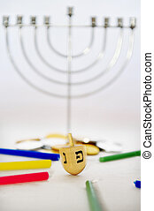 Hanukkah - Dreidels and Gelt - Photo of a dreidel (spinning...