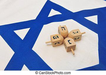 Israeli Flag with Wooden Dreidels - A white and blue Israeli...