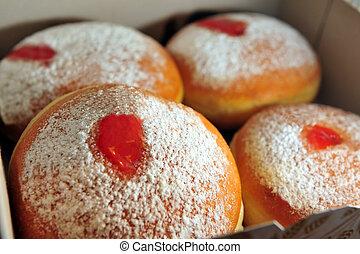 Hanukkah - Donuts (sufganiyot - Fresh sufganiyot in a...