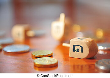 Hanukkah - Dreidels and Gelt - Photo of dreidels and Gelt...