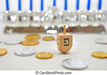 Isolated Obejects for Hanukkah - Photo of a dreidel spinning...