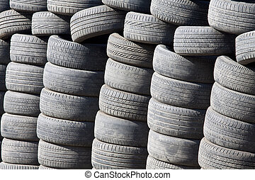 Many tyres and wheels under sunshine
