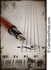 Sheet music grunge - A fountain pen on sheet music in a...