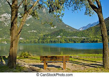 Empty bench near the coast of a lake