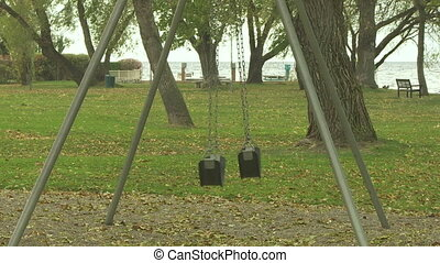 Empty Swings 03 - Empty swings in a deserted playground