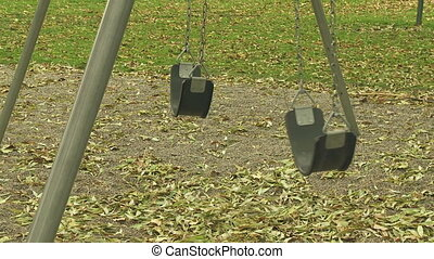 Empty Swings 02 - Empty swings in a deserted playground