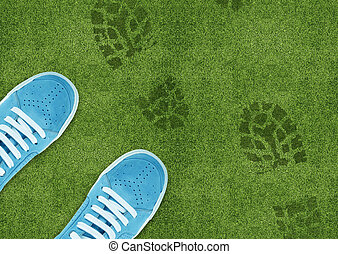 Shoe print on green grassland - Blue Shoe print on green...
