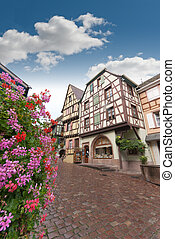 Street in Alsace - Cobbled street in Alsace with half...