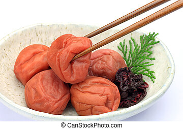 pickled plum  - This is called umeboshi by Japanese food.