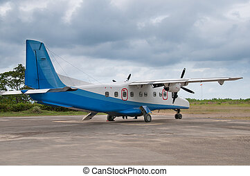 Propeller plane - An old propeller plane on a small runaway