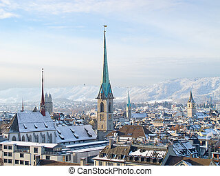 Zurich in winter - Famous Zurich churches covered by first...