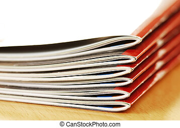 Magazines stack - stack of same magazines with red covers...