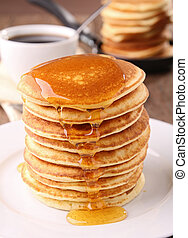 pancakes and syrup - stack of pancakes with syrup
