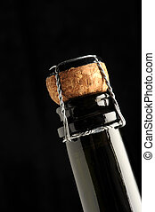 sparkling wine cap on black background