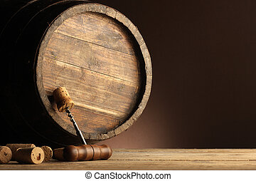corkscrew and wooden barrel