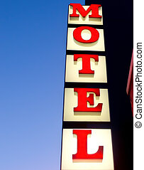 Closeup of vintage lighted motel sign against blue sky