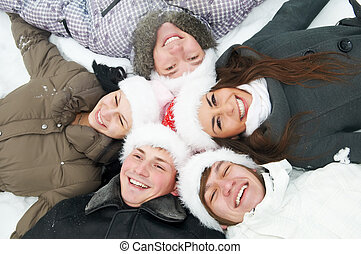 group of young people in winter
