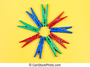 Pegs. - Pegs on yellow background.