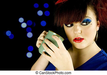 teenage girl with hot drink in hands