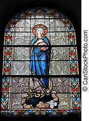 Stained glass window with catholic scenes