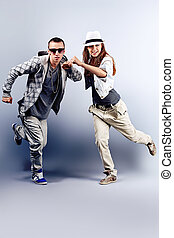 freestyle - A couple of young man and woman dancing hip-hop...