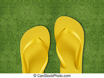 Yellow Flip Flops on green grass, summertime