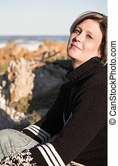 Woman on the beach - Beautiful adult woman with short hair...