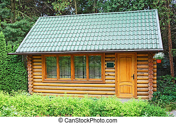 Carpatian hut in forest - Modern traditional ukrainian...