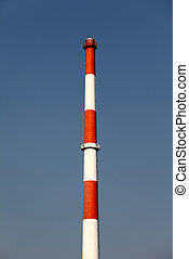 Smokestack on a blue sky background