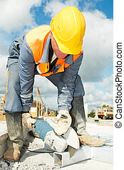 builder working with cutting grinder saw - Builder worker...